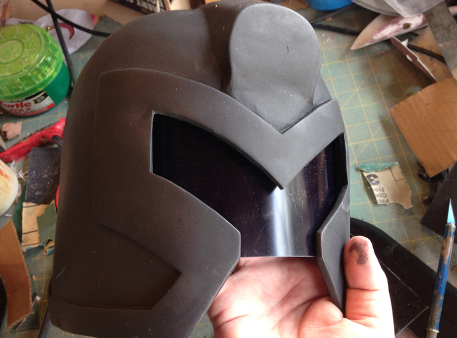 The helmet got a base coat of flat black. I also cut a welding face shield for the visor.