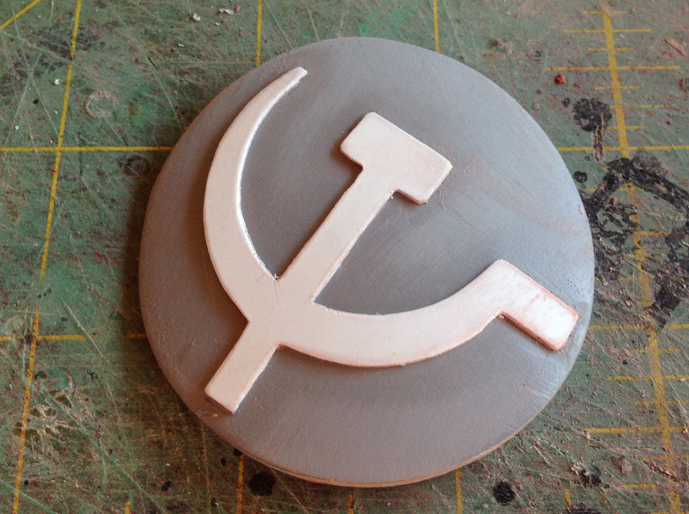 I drew and cut out a styrene plastic hammer and sickle and glued it to the emblem (reversed in the comic book universe.)