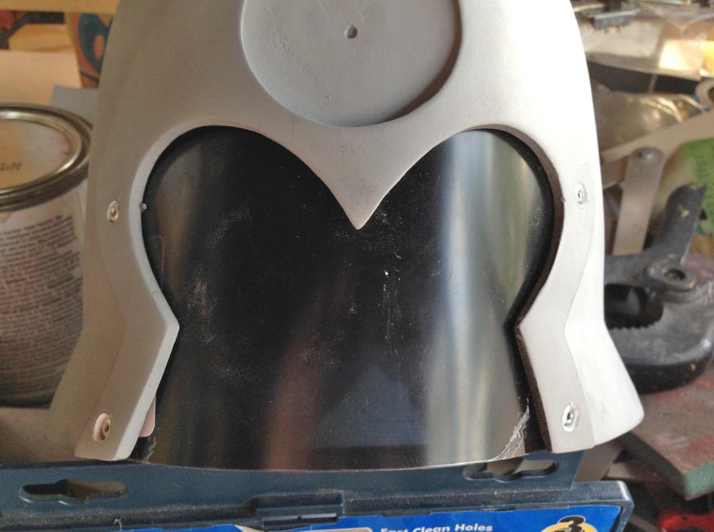 The visor was secured with pop rivets. The holes were filled with Bondo and sanded smooth.