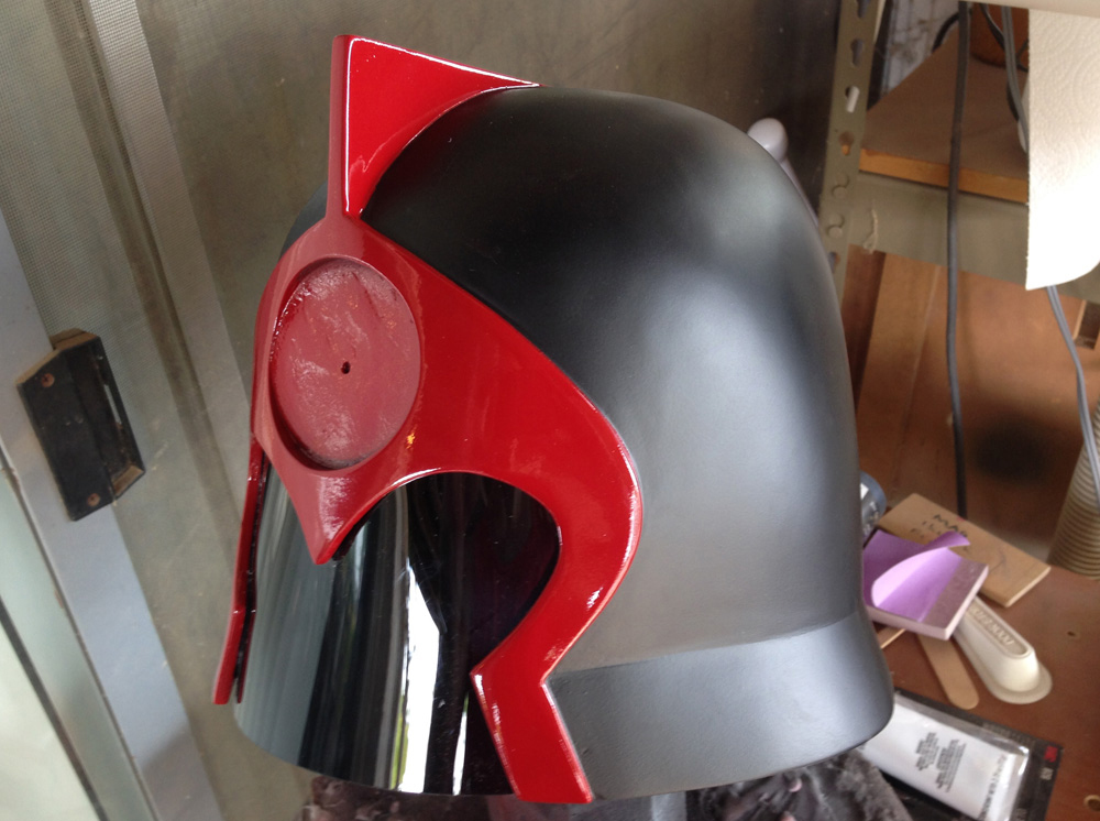 The helmet was painted with flat black paint with a glossy red faceplate.