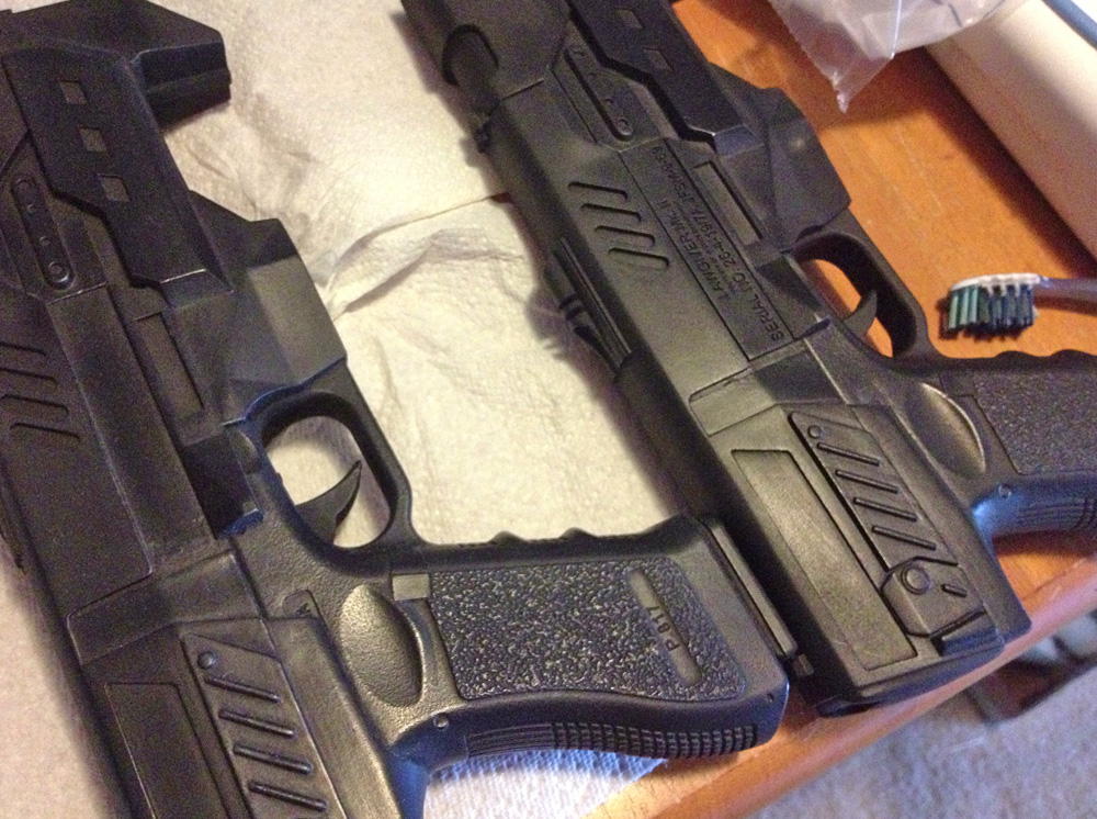 A Judge's sidearm, the Lawgiver, was purchased as a foam filled, resin casting of a 3D printed model