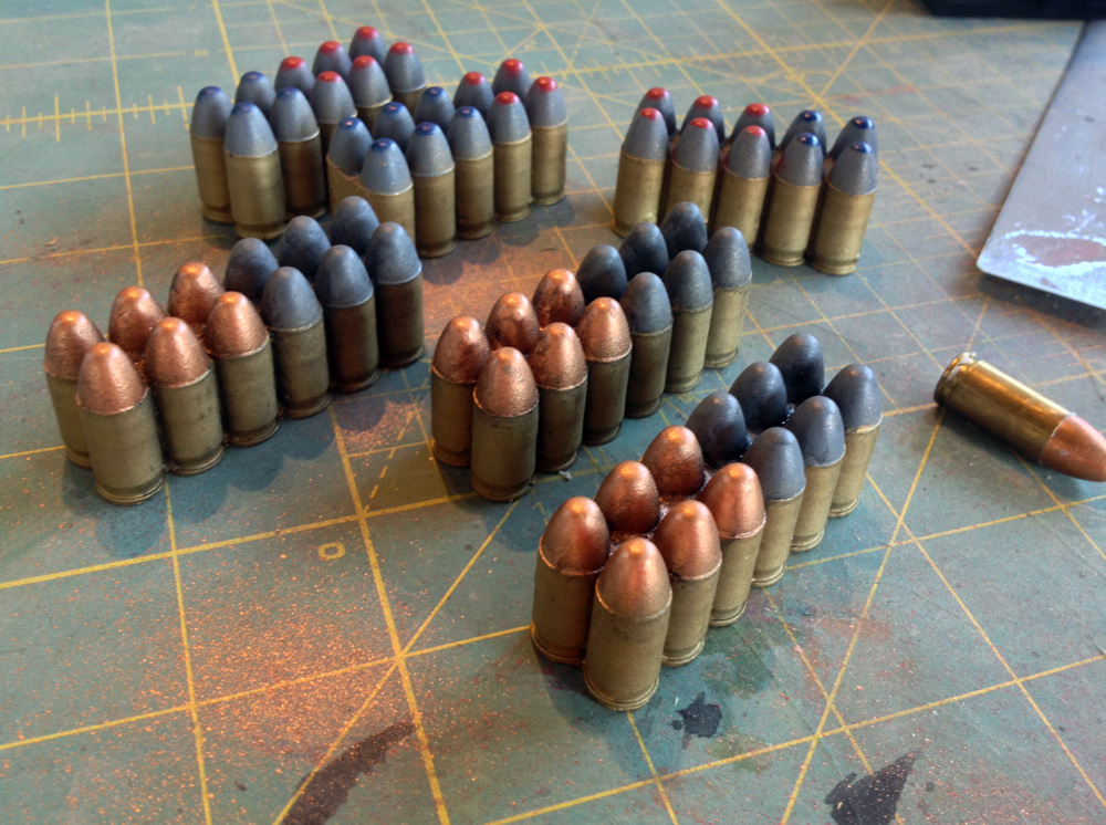 Since the shells are visible in the front magazine, they needed to be painted. The film version looked silver but I opted for a more real world color scheme of brass for the shells and color-coded tips for each type of round.