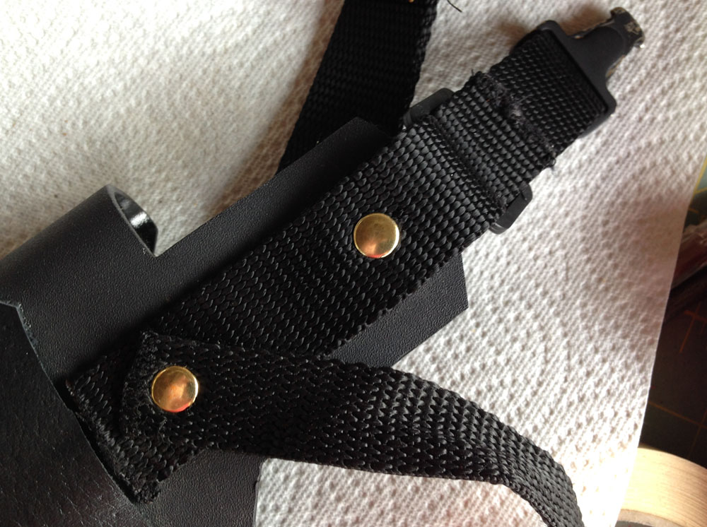 The strap was riveted to the back of the kydex along with a retaining strap.