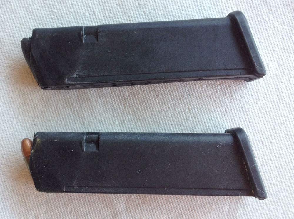 I needed four 19-round Glock magazines but they don't exactly come cheap! I bought one magazine, inserted a round and molded it. Using Smooth-On Onyx, I made four passable copies with foam cores to save on weight (copy on top).