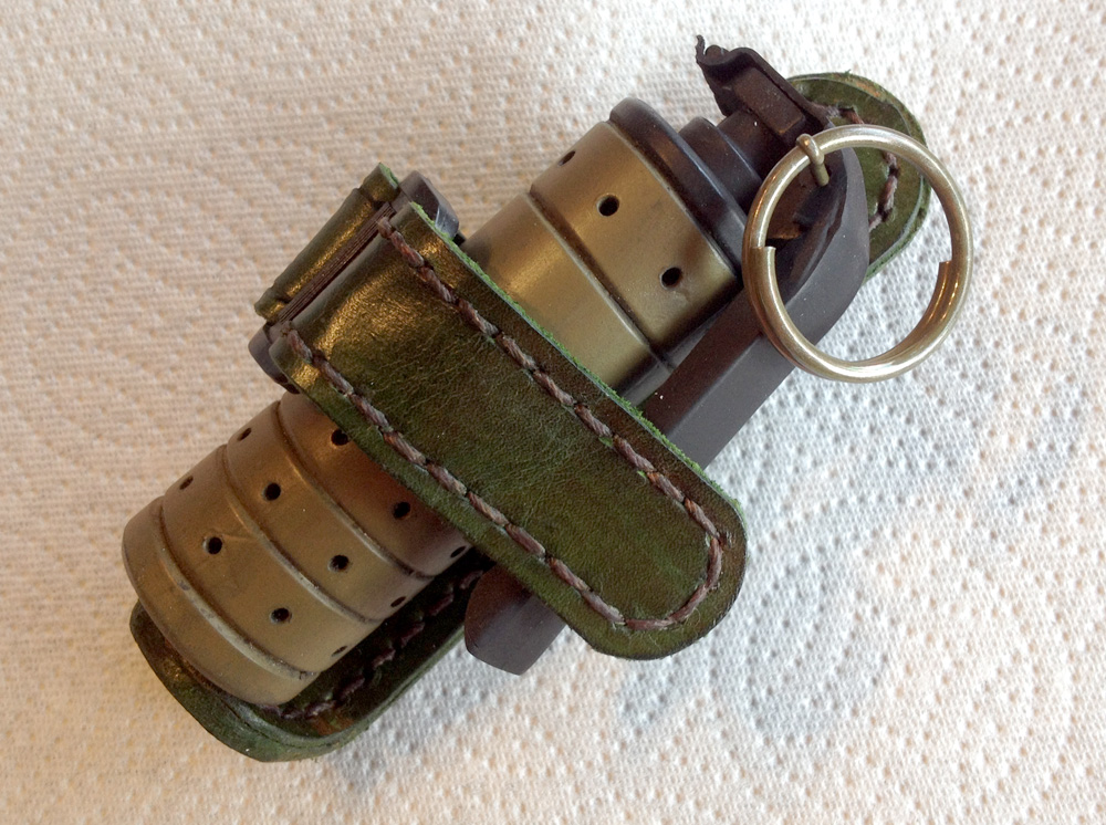 Grenade in its belt pouch.