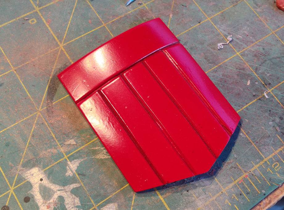 I cut some channels into the Sintra and smoothed out the finish with gloss paint.