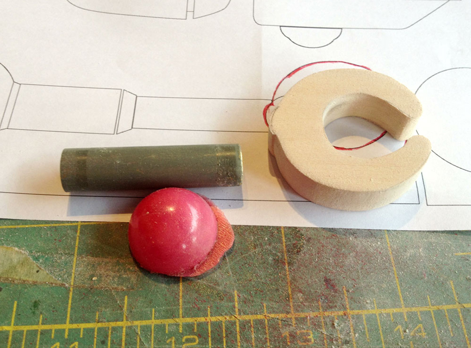 The claw base was cut from a piece of basswood. The forearm master was a brass tube of the proper diameter and I found a reject resin gem that I could use for the hand rivet.