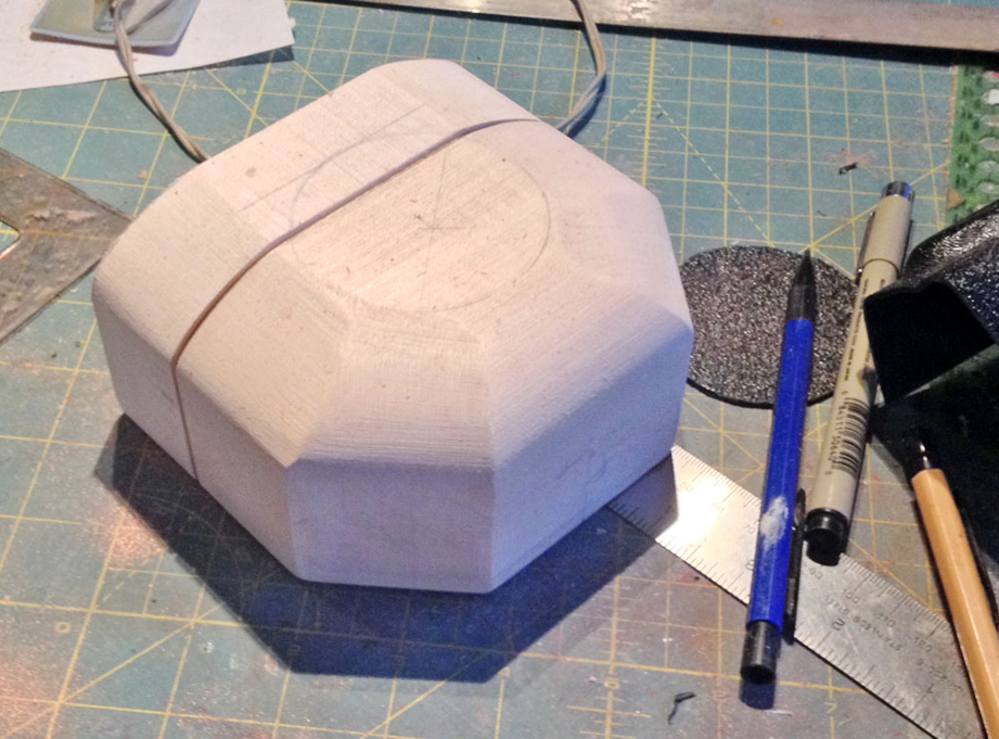 I marked the circular base and then cut and sanded the bevels.
