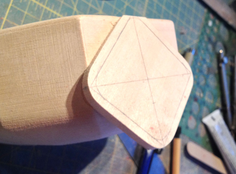 I cut a piece of basswood to make the chest shield and sand an angle to the back so it sits properly.
