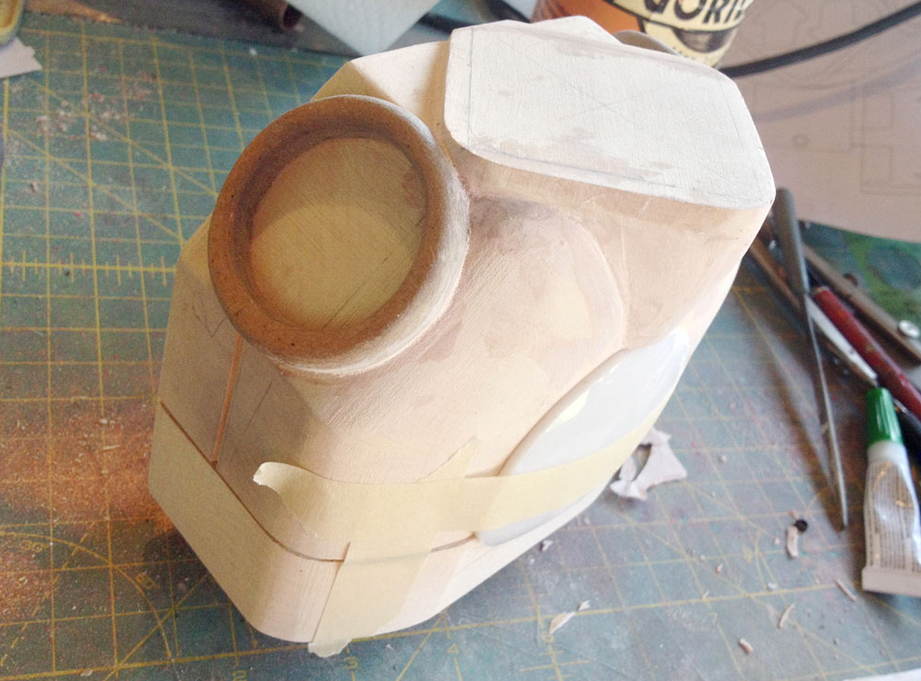 With the arm borders glued, I used Bondo to fill in the space between the chest plate and the torso.