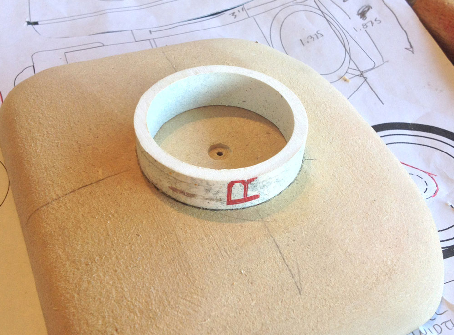 A PVC pipe is cut and glued into the hole.