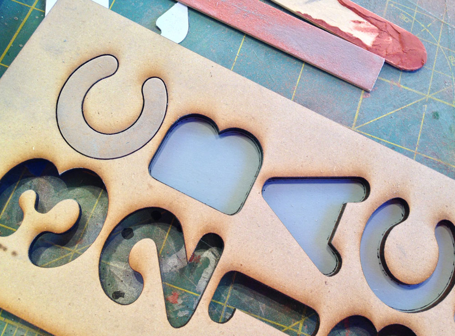 """I had the letters for the tread laser but from 1/4"""" MDF by Scorpion Ridge Engraving. The unused parts made a nice template for glueing the letters and numbers down to the base."""
