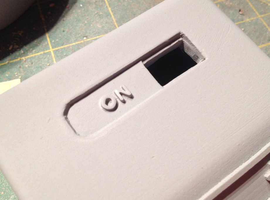 These were glued into the recessed slot, low enough to pass under a switch cover.