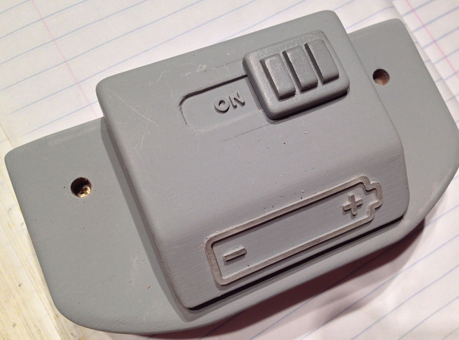 A switch cover was made from MDF and glued over the electronics switch lever.