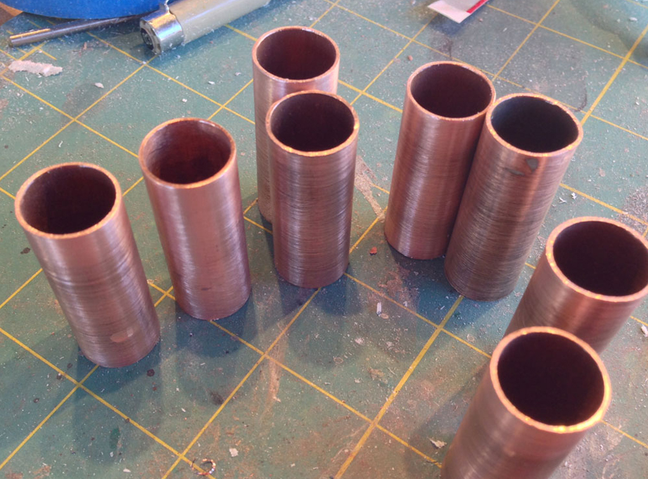"""I cut segments of 1/2"""" copper pipe for the upper arms."""