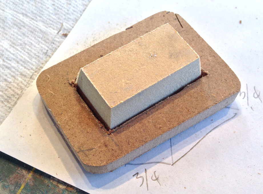 To make domes that would fit over the light banks, I made a block and frame from MDF to form the plastic over.