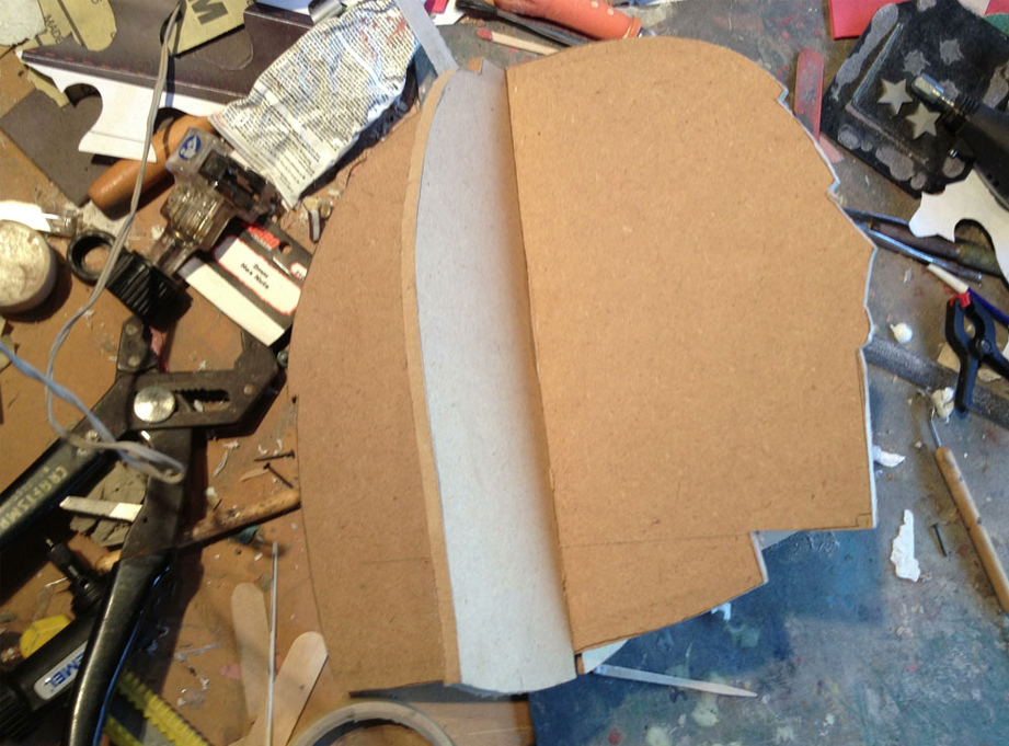 I started by cutting profiles of the helmet from 1/4″ MDF to act as guides while I sculpt. I cut slots in each and slid them together.