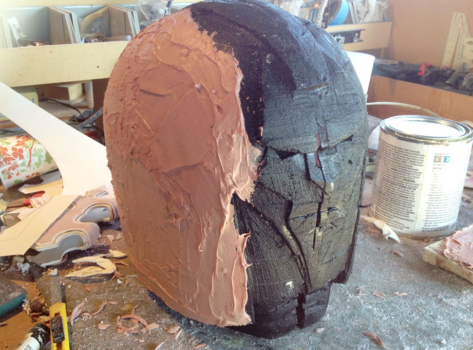 Next I sealed the foam with acrylic paint and then added a light coat of Bondo over the entire surface.