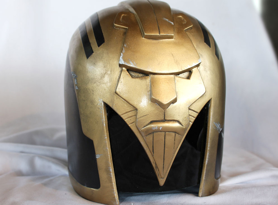 Next, it was time to beat up the helmet with files, rasps and saws to match the battle damage on Dredd movie Judge helmets. Adding silver nicks and scratches and a level of Mega-City grime was enjoyable though. The gold looks better too!