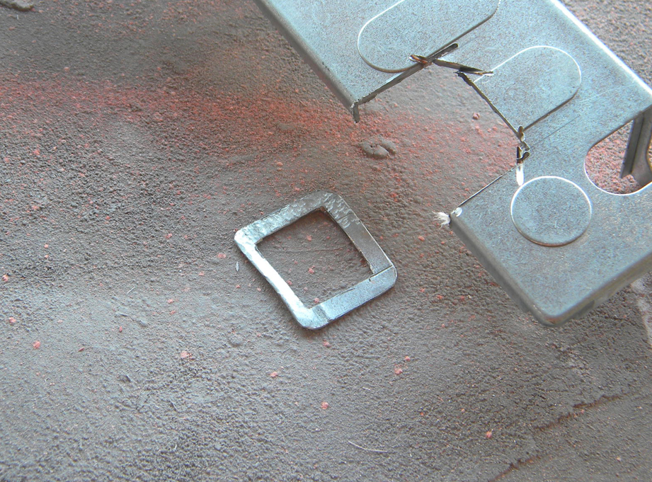I cut a buckle from a scrap of steel.