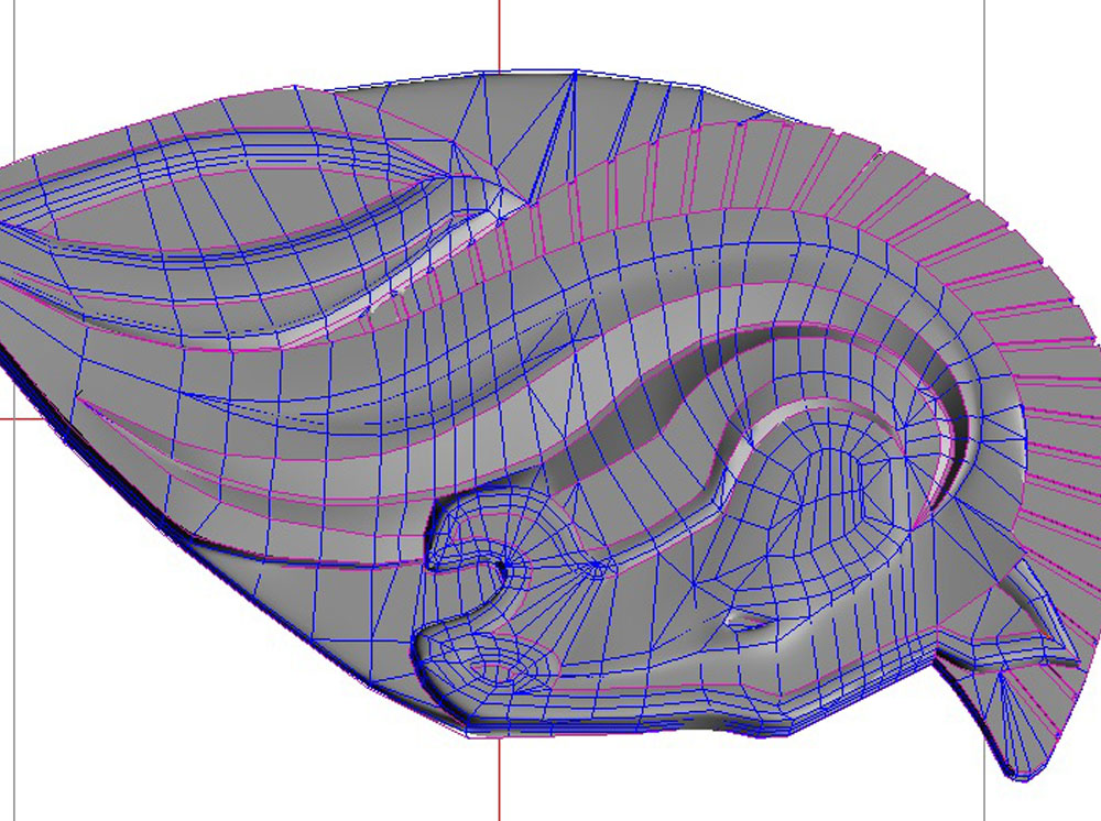 In sculpting the main horse, the software smooths the edges between polygons so you can describe curves with simple geometry. The purple lines are designated as hard edges.