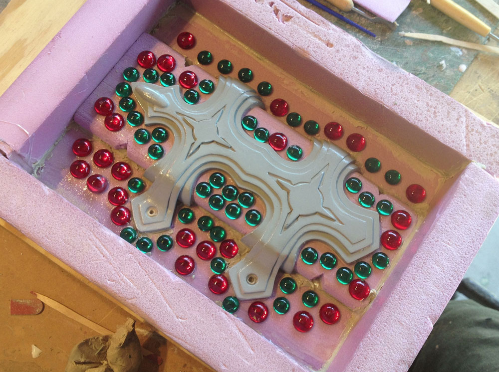 I poured silicone for each side. Acrylic cabochons were used for keys to align the mold parts.