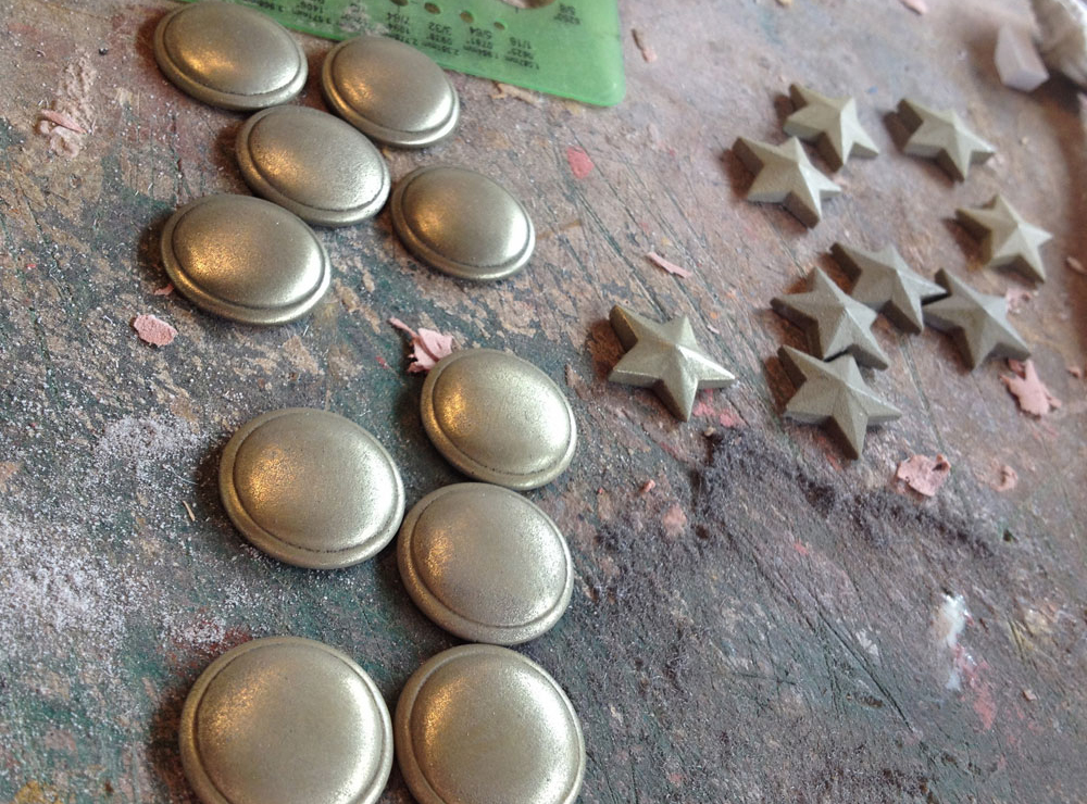 "I mixed brass powder into resin to ""cold cast"" the knuckle plates and stars. These were polished to a metallic shine with 000 steel wool."
