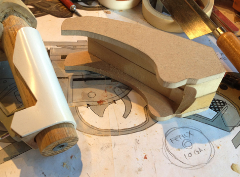 I glued more MDF together to make the outer grip.