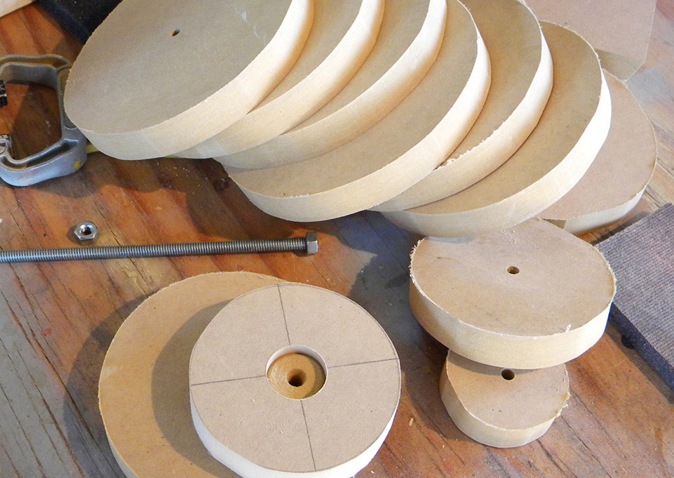 I started by cutting 3/4″ MDF into discs that could be glued together on a threaded rod.