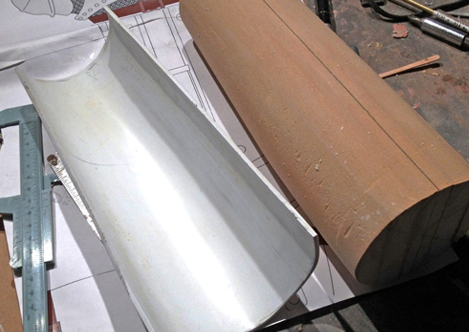 I started the vambrace (part that covers the forearm) by lathing a MDF master that roughly matched my forearm. I heated thick styrene and wrapped it over the form.