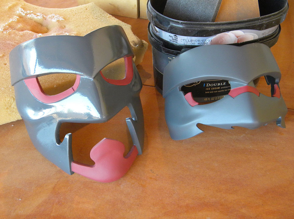 After the red areas were painted, I applied a protective coat of matte finish Crystal Clear. The half mask here shows can see how much of a difference the matte finish makes.