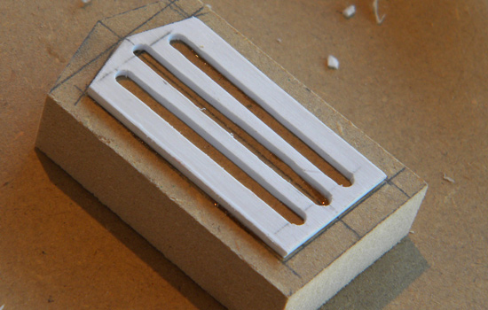 A detail block for the front plate was cut from MDF with a grill cut from styrene.