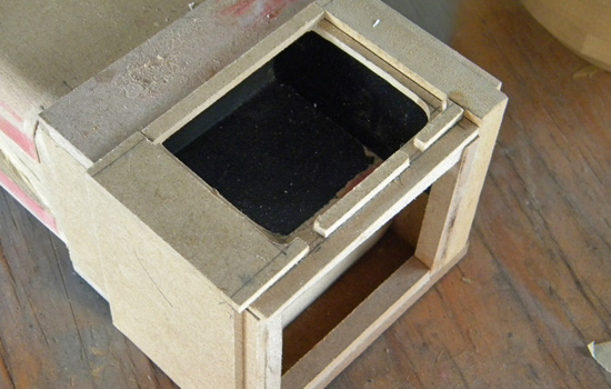 "I framed the layers of the butt cap with 1/4"" and 1/8"" MDF, cutting a hole for the battery compartment."