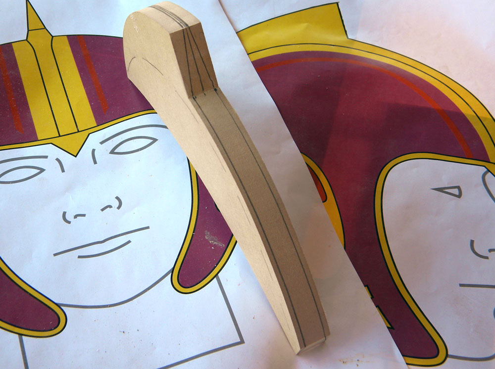 """I cut the crest profile out of 3/4"""" MDF, and marked where it would need to be sanded to match the taper of the plans."""