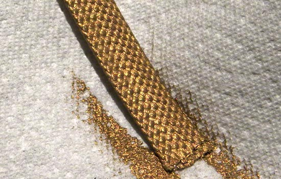 I wasn't able to find gold ribbon in the proper width, texture and color make Rekki's scabbard ribbon, so I found the closest match in size and texture and painted it with gold acrylic.