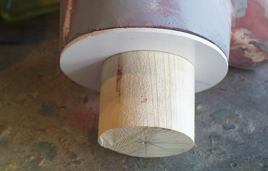 I capped the neck with a disk of styrene and attached a cylinder of basswood to fit inside the screw shaft.