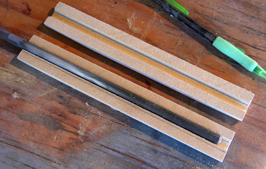 I cut channels for the steel support rod in MDF grip halves.