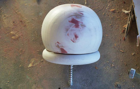 The finial ball and disk glued together over a threaded mounting rod.