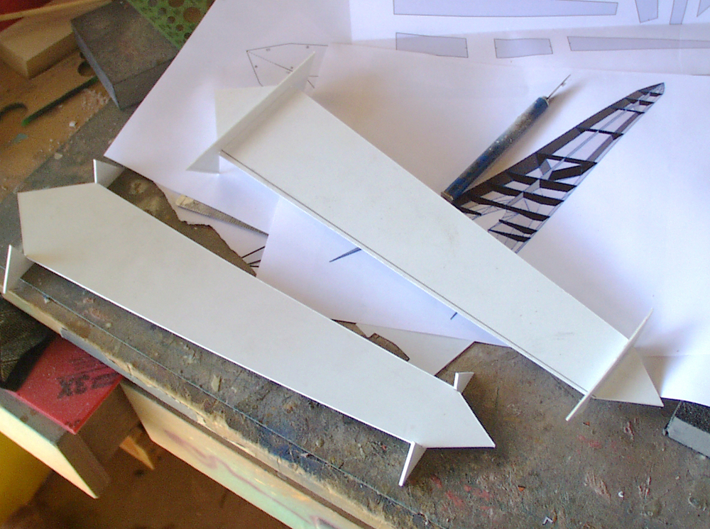 The recessed areas on the lance head were made from styrene. I used Pepakura to work out the geometry.