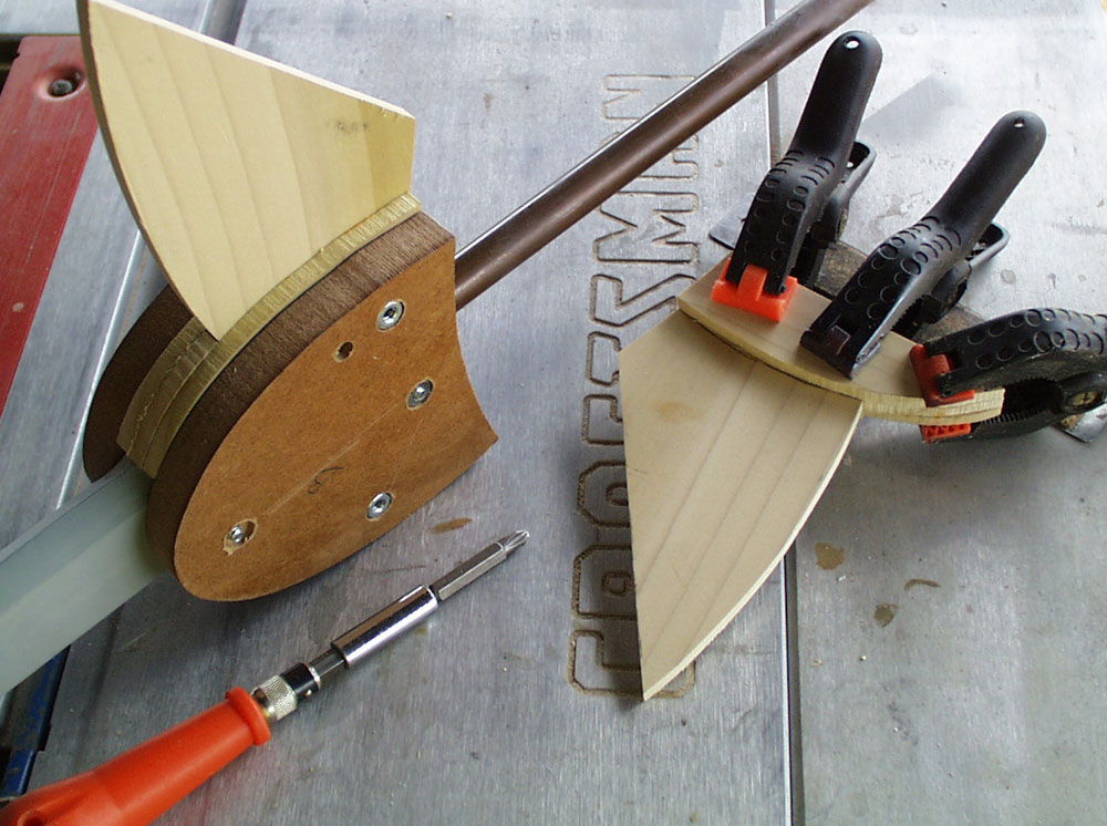 I then cut the wings from 1/4″ poplar and filled the gap between the MDF with more poplar.