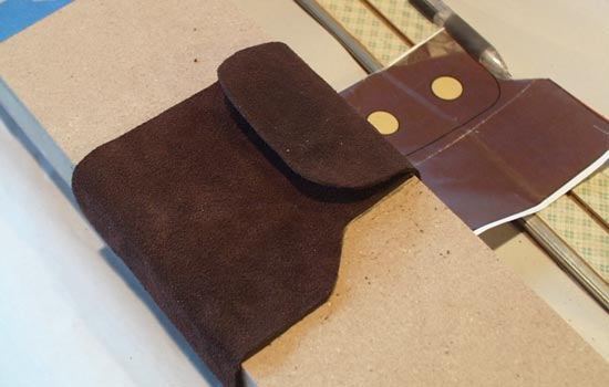 I found some nice thick leather to wrap around the scabbard.