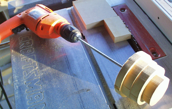 """I stacked MDF and sanded it to shaped on a """"poor man's lathe"""" to make the dome."""