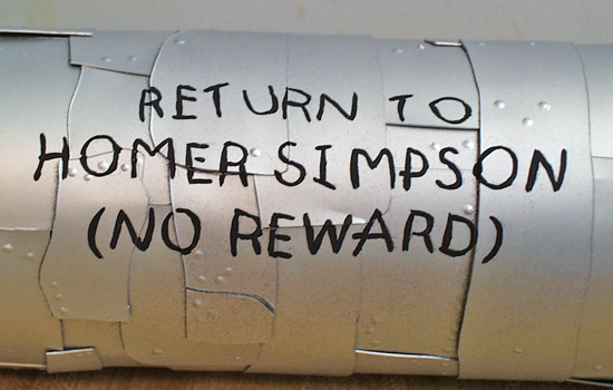"""…and his """"Return"""" message on the back."""