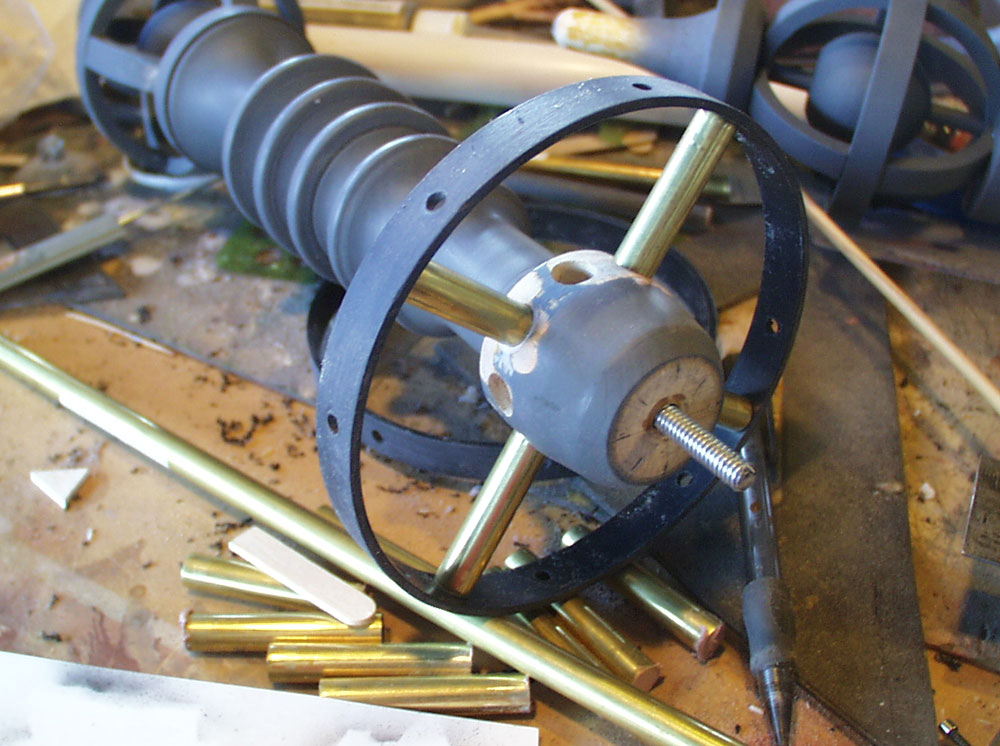 I used brass tubes drilled into the wood to support the plastic ring.