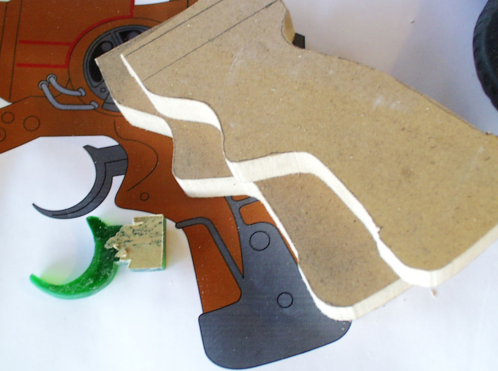 I made a master for the trigger out of a scrap of green acrylic. The grip halves were cut from 3/4″ MDF.
