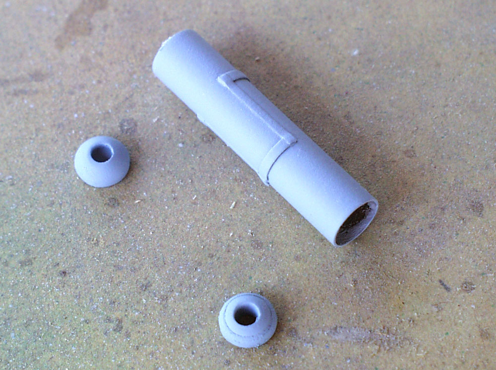 The rear sight was made by drilling a hole in acrylic cabochons (domes) and gluing them to the ends of a brass rod.