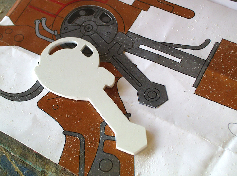 The breach lever arm base was cut from thick styrene plastic.