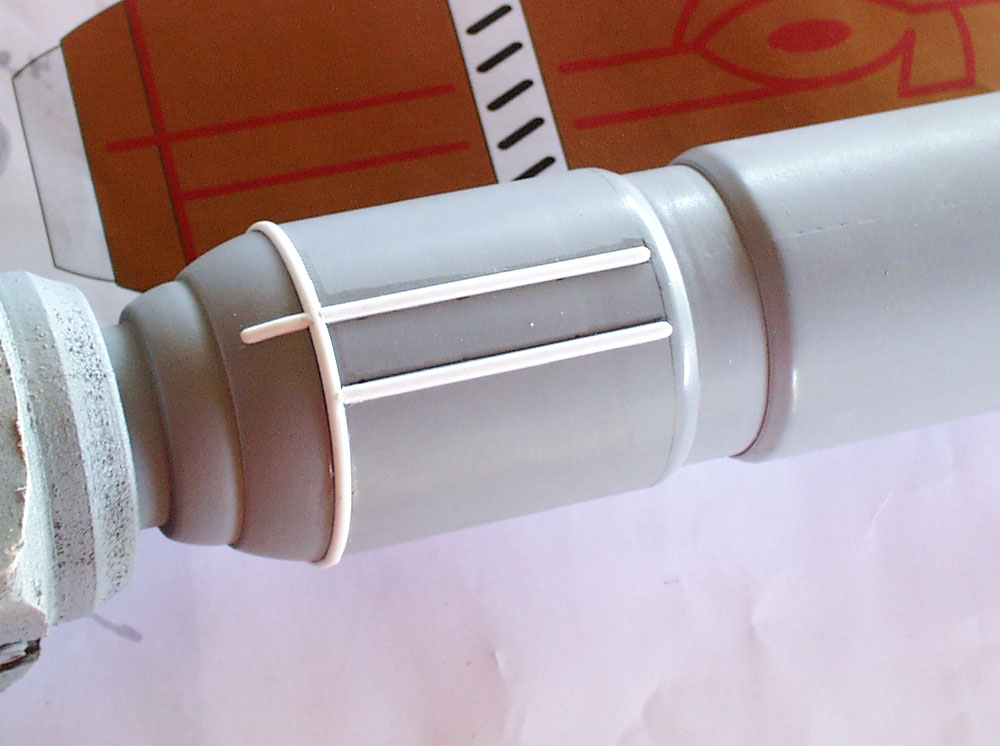 I added the piping to the barrel with half-round styrene.