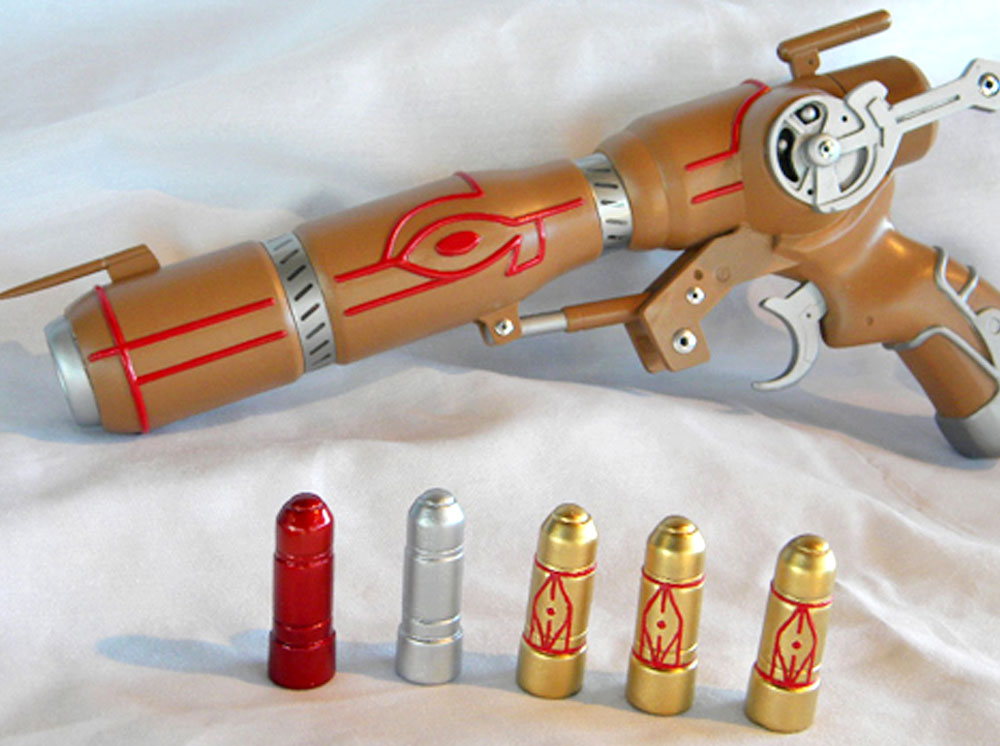 The final pained gun. After testing over a dozen different paints, I found the perfect Caster Gun brown! It has golden tints (that I mistook for gold on my original Caster) but is light enough to contrast nicely with the red piping.