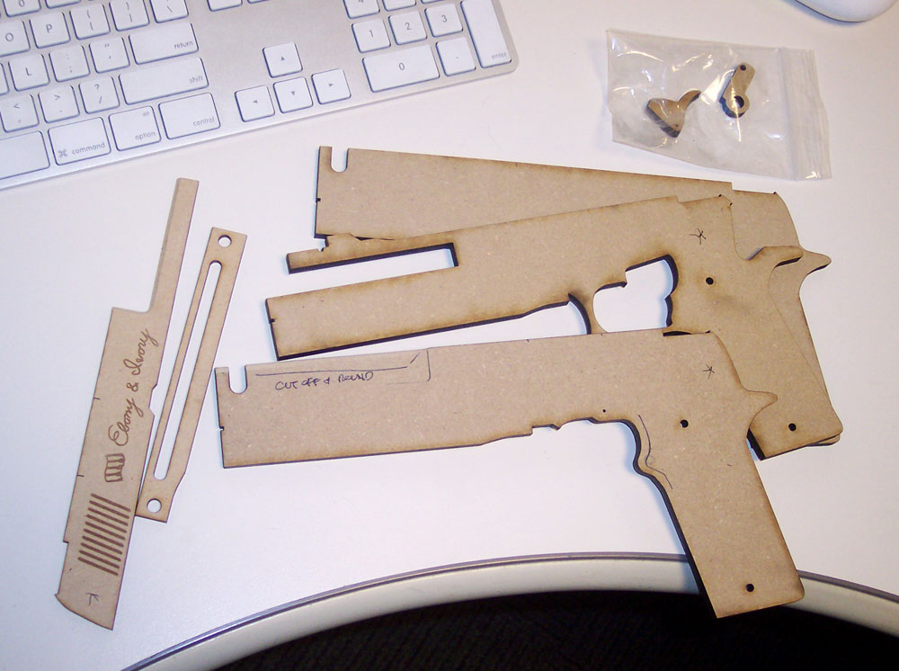 I planned out the guns so they could be built using layers of laser-cut MDF. This would allow for maximum accuracy as well as the engraving on the barrels.